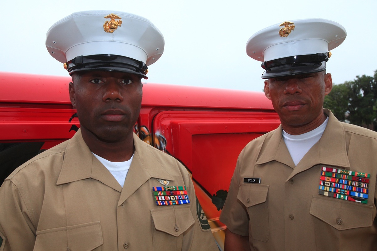 Sgt. Maj. Brian Taylor, recruting station Baltimore sergeant major, and Gunnery Sgt. Maurice Bease, Headquarters and Headquarters Squadron squadron gunnery sergeant, in attendance at a recruit graduation aboard Marine Corps Recruit Depot Parris Island, April 6. Taylor and Bease hadn't spoke in 10 years after an unfortunate rumor of Bease's death in the 9/11 attack on the Pengtagon spread.