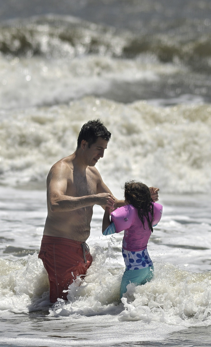 "Despite wearing inflatable ""swimmies,"" this little girl never got out of arm's reach Tuesday afternoon June 26 at Hunting Island State Park."