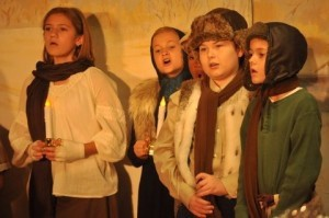 Scenes from Holy Trinity Classical Christian School's Christmas play.