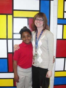 Music  Specialist Kristin Brady from Lady's Island Elementary School stands with fourth grader Jada Brodus who was accepted into the 2013 SC Elementary Honors Choir. Jada was selected in a statewide audition and was sent a challenging repertoire of music to learn. Ms. Brady began the task of preparing Jada for the weekend of rehearsals in Charleston on Feb. 7-8 . The final performance will held on Saturday, Feb. 9.