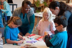 E.C. Montessori students get the opportunity to learn quilting by making their own quilt with the help of volunteers at the Penn Center.