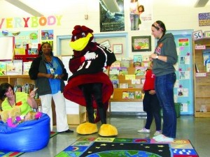 Lady's Island Elementary School kindergarten and first grade students had a surprise visitor last week.  Cocky, the beloved mascot from the University of South Carolina, came with students from USC. The students read to the children, and Cocky helped the children understand the importance of life-long reading. The students made a promise to read every day and each child received a book to take home, even the Clemson fans!