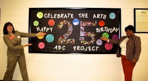 Lady's Island Elementary School Principal Marvelle Ulmer and Director of the ABC Project Christine Fisher pose with a Happy 25th Birthday bulletin board.