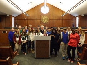 The Lady's Island Middle School Junior Leadership class visited downtown Beaufort for a day of learning about Beaufort's government and history. The government lesson was delivered by Mayor Keyserling with assistance from Ivette Burgess. The Mayor gave the class an overview on how local government works and how the mayor and the community interact with each other to solve problems and issues. After Mayor Keyserling spoke in the City Council chambers, the class had the opportunity to visit the Beaufort Museum on the bottom floor of City Hall. Mrs. Lang gave a detailed tour about Beaufort's past. Then the class visited the Beaufort National Cemetery on Boundary Street where Mrs. Pat Simmons talked to the leadership class about how the cemetery began under the direction of Abraham Lincoln in 1863. After having lunch at Henry C. Chambers Waterfront Park, the class had the opportunity to learn about Beaufort's past from Southurn Rose Buggy Tour. Larry was our knowledgeable tour guide and Rocky pulled the carriage around town. As the students viewed the antebellum homes and beautiful gardens, the class began to understand the importance of the past and how as young leaders they can begin to shape Beaufort's future.