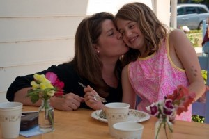 Suzanne Lataille kisses daughter, Grace, during the Mother's Day picnic at E.C. Montessori School on Lady's Island.