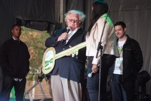 """Mayor Keyserling presents Candice Glover with a """"key' to the city on stage at the American Idol concert last Saturday in downtown Beaufort. The key is made out of indigenous Bull Rush grass from a local basket weaver."""