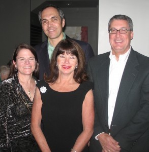 The owners of Rossignol's are Ginger Aimar, far left, and Charles Aimar, far right, seen with store employee Kathleen Linn and jewelry designer John Wind.