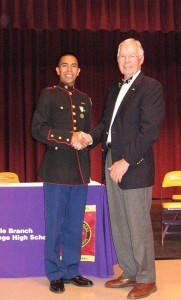 """On May 10, 2013, the Gov. Paul Hamilton Chapter of the Sons of the American Revolution presented the SAR JROTC Bronze Medal to Whale Branch Early College High School Marine Cadet Capt. Jonathan Dominguez.  The medal is approved by the United States Army, Navy, Marine Corps and the Air Force, and endeavors to foster the principle of """"citizen-soldier"""" exemplified by the Minutemen. Recipients are selected for a high degree of merit with respect to leadership, qualities, military bearing and general excellence by the Commanding Officer of the JROTC unit. Caption: Marine Cadet Capt. Jonathan Dominguez of Whale Branch Early College High School receives the SAR Bronze Medal from SC SAR Vice President Wayne Cousar of Seabrook."""