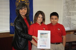 """On March 14, The Exchange Club of Beaufort presented the 4th grade students at St. Peter's Catholic School the """"Proudly We Hail"""" award for properly displaying our American flag. Each student was also awarded a certificate at the Children's Mass on Friday, March 15, by the club's president."""