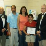 Beaufort Academy fourth grader Riley Gates was recognized as the winner of the National Society Sons of the American Revolution poster contest for the Gov. Paul Hamilton Chapter.  South Carolina Sons of the American Revolution President Jody Henson, and Past President/Current Education Programs Chairman Wayne Cousar, presented Riley with a recognition certificate and a $300 check.  Riley's poster will make its way to Kansas City for the national competition in July. Pictured is Jody Henson, Riley's parents Bryan and Tammy Gates, Riley, and Wayne Cousar.