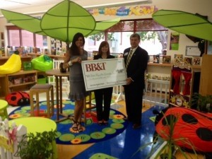 Bethany Marcinkowski and Tina Gentry of United Way of the Lowcountry and Eric Lowman of BB&T are in the Reading Garden at St. Helena Elementary School on St. Helena Island.
