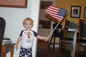 Our All-American Baby with his favorite flag.