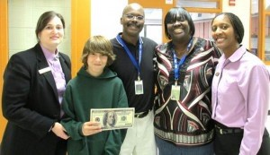 """Mr. Michael Glaze (center), Lady's Island Intermediate and Middle School teacher, won $100 for classroom supplies after his student, Brandon Cassidy (center left), entered him in the """"Favorite Teacher"""" contest at Dr. Skeet Burris and Dr. Travis Fiegle's practice Winning Orthodontic Smiles. Also pictured:  Janet Villalta and Ann Paige representing Winning Orthodontic Smiles, and Lady's Island Intermediate & Middle School Principal Mrs. Mona Lisa Dickson."""