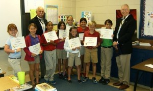 Jody Henson, left, with Beaufort Academy 4th grade students Ansleigh Pingree, Emma Dillinger, Kevin Rogers, Taylor Parker, Alyssa Lewis (back), Emily Wilson (front), State Poster Winner Riley Gates, Witt Compton, Anthony Gonzalez and Wayne Cousar.