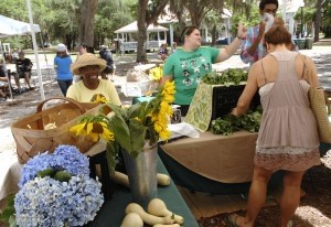 Delores Jeffries, left, of St. Helena Island was all smiles while selling her fresh vegetables and flowers at the farmers market.