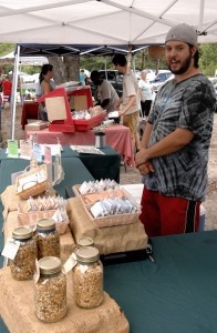 Matt Frommer  displays some of his all natural food Saturday during Port Royal's farmers market. Frommer said he is the owner and chef and does everything himself.