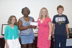 The award recipients for the Young Leaders' Scholarship Program sponsored by The Beaufort County Education Association are seen at the presentation ceremony and reception held on Wednesday, June 5 at ACE (Beaufort-Jasper Academy for Career Excellence). Pictured above, from left: Award recipient Caitlyn Owen, 5th grader from Hilton Head International Baccalaureate Elementary; The Beaufort County Education Association president Dr. Delphine Gillard holding a check for $100 for The BCEA Young Leaders' Scholarship Program donated by CPM Federal Credit Union; Presenting the donation is Caitlin Melton, representative from CPM Federal Credit Union headquartered in Charleston; Award recipient Sam Derrick, seventh grader from Lady's Island Middle School.