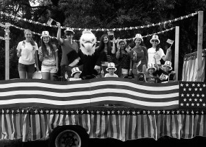 BA students wave to the crowd during the 2013 Beaufort Water Festival Parade.  Pictured left to right: (Front row) Braxton Hines, Thomas Hines, Grace Simmons, G Simmons.  (Back row) Anna Dyer, Courtney Smith, Avery May, Screech, Ashley May, Chloe Nickles, Kate Gray, Madeleine Gray.