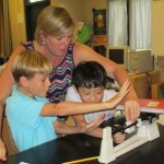 Mrs. Luckey works with students Ben Lubkin and Thomas Tram.