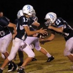 Quarterback Melville hands the ball off to his workhorse running back Reyn Robinson, who rushed for more than 350 yards and led to the Eagles win, 54-48.