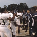 Co-captains for the Battery Creek Dolphins, left, shake hands with their counterparts from Hilton Head Seahawks before the start of the game at The Nest on Hilton Head Island.