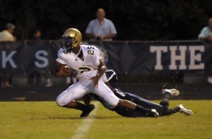 Battery Creek's #2 gets tackled at the five-yard line last Friday night in Hilton Head Island. The Dolphins scored on the next play.