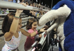 Two young Battery Creek fans play with the Dolphin mascot.