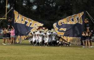 The Battery Creek Dolphins traveled to Hilton Head Island last Friday to face their former regional river Hilton Head High School Seahawks. The Seahawks defeated the Dolphins 48-20. Above, The football team bursts through the banner to kick off the game.