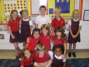 Students in Ms. Lori Hinson's first grade class gather for a group shot on the first day of school.