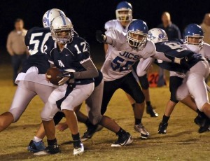 Beaufort Academy quarterback #12 looks to hand off the ball last Friday against James Island Christian.