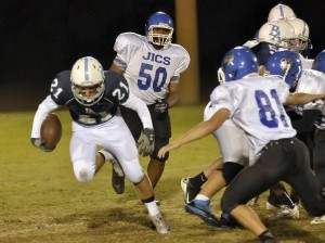 Beaufort Academy running back Reynolds Robinson regains his balance and breaks for extra yards.