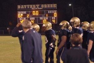 Coaches and players look on as the clock ticks to zero last Friday night following Battery Creek's 62-0 victory over the Burke Bulldogs.