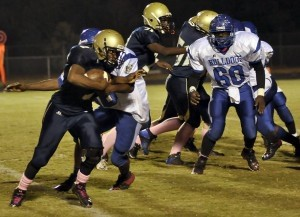 Battery Creek High School Dolphins took Burke High School to the wood shed last Friday night by beating the  Bulldogs 62-0 in Region 6-AA play. The Dolphins improved their overall record to 4-5 and 3-3 in the region. Battery Creek running back gains extra yards behind solid blacking as the Dolphins cruised to a 62-0 victory of the Burke High School Bulldogs.