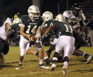 Beaufort High School quarterback  Ben Vaigneur gets ready to hand the ball to his running back last Friday night at BHS.