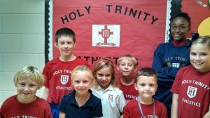 """Several Holy Trinity Classical Christian Grammar and Middle School students displayed an exceptional example for others in Physical Education Class. They kept a positive attitude and gave their best efforts throughout class and were awarded as """"Pe Primi's"""" of the week. Primi is a Latin word meaning """"first in class,"""" """"top notch,"""" """"first."""" It's the plural word for Primo. Front Row: Bray Sheehan, Izzy Harter, Shelby Luby, Scarlett Mercier. Back Row: Luke Greene, Reagan Wyatt, Mark Gilbert and Tatiana Forbes."""