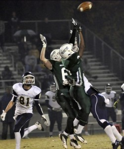 A pair of Beaufort High School defensive backs goes up for the ball and knocks it down. The Eagle defense held Blythewood to only 15 points.