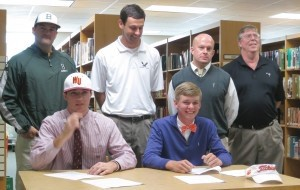 Senior Carson Gregory, left, signs an early letter of intent next to longtime friend Josh Fickes. The students are flanked by Beaufort High Baseball Coach Keith Riley, Coach Brian Merrick, Coach Brooke Dixon and personal golf coach, Jim Pike.