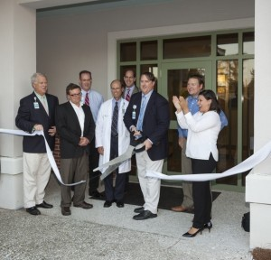 AT LEFT: Beaufort Memorial Physicians Partners Executive Director Sam Derrick cuts the ribbon at the new Lady's Island Internal Medicine facility. From left: BMH President Rick Toomey; Dr. Randy Dalbow; Regional Practice Administrator Dana Schroeder; Dr. Philip Cusumano; Dr. Robert Vyge; Sam Derrick; Beaufort Regional Chamber Chairman Stephen Murray; Chamber President Blakely Williams. Photo by Paul Nurnberg.