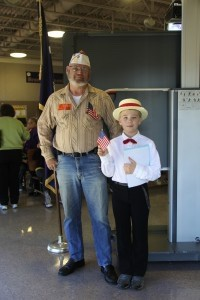 Veteran Kenneth Dennings, Jr., Vice Commander of the V.F.W. Post 8760, stand with fourth grade Leadership Club member Caiden Faircloth. Dennings assisted in set up and greeting students and guests during Lady's Island Elementary School's annual Patriotic Assembly held Friday, Nov. 8.