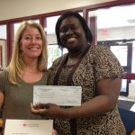 Bet Rhodes presents a check to Lady's Island Middle Principal Mona Lise Dickson.