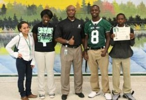 """From left: Maria Guzman-Rojas, Jessica Simmons, Eric Blakely and Tramone Jenkins represent Beaufort High's PBIS (Positive Behavioral Interventions & Support) Committee and its """"Eagle Pride"""" program."""