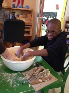 Titus Wilson, an elementary student at E.C. Montessori and Grade School, prepares rolls from scratch for the Thanksgiving Celebration held at the school on Lady's Island on Friday, Nov. 22.