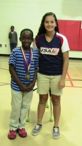 Lady's Island Elementary School recently held its first sport stacking meet of the season.  First-place age group winners included Joab Stephens, Elizabeth Santos, Arthur Singleton, Antwan Simmons, and Tray'Von Day (pictured above, at left). Tray'Von was presented the All Around Champion medal by Anna Smith, former LIES stacker and current female world record holder. Anna is hoping to compete in the 2014 World Championships in South Korea. Anyone wishing to help sponsor her trip can contact her at afs06261998@gmail.com.