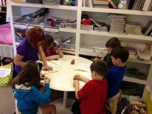 """Bridges Prep second grade students are exploring magnets. Last week, they learned all about magnetism. This week, students are applying what they learned, experimenting with magnets in activities such as """"How many paper clips can be held by different types of magnets?"""""""