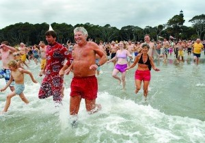 Participants in the fifth annual Pelican Plunge show varying degrees of discomfort as they splash their way into the surf at Hunting Island State Park on Tuesday, January 1, 2013. Photo by Bob Sofaly.