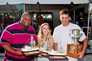 Winning restaurants hold trophies at the annual Shrimp Festival in October.