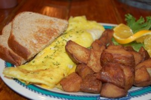 Three egg omelette with wheat toast and roasted potatoes.