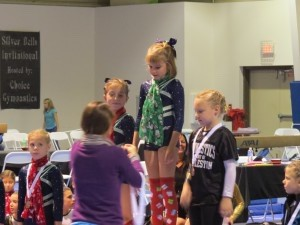 Island Gymnastics's team member Alex Compton, middle, attends Beaufort Academy and won first all around in her division at the recent Silver Bells Invitational meet in Hanahan, SC.