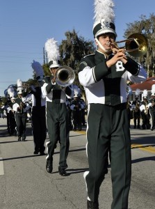 It wouldn't be a parade without marching bands. Both Battery Creek and Beaufort High School bands participated and performed. Here, a trumpeter from Beaufort High plays his horn.