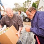 Mike Covert, left, unloads food donations from his truck to HELP of Beaufort at 1910 Baggett St.